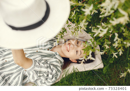 Stylish woman spending time in a spring park 73328401