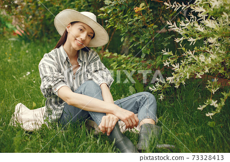 Stylish woman spending time in a spring park 73328413