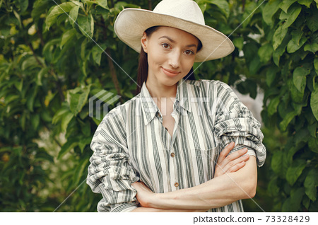 Stylish woman spending time in a spring park 73328429