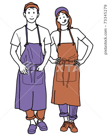 Young man wearing an apron 73345279