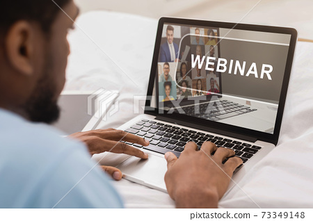 African-american man having webinar on modern laptop 73349148