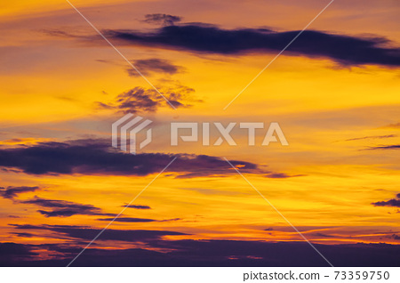 dark clouds on the glowing sky at sunset. dramatic nature scenery on the windy weather in evening 73359750