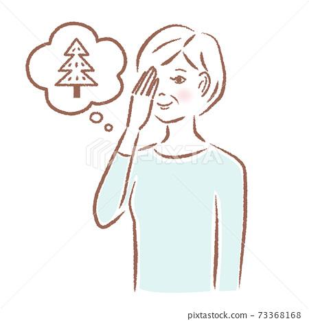 Woman checking eyesight 73368168