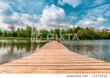 Lake for fishing and recreation with pier 73375658