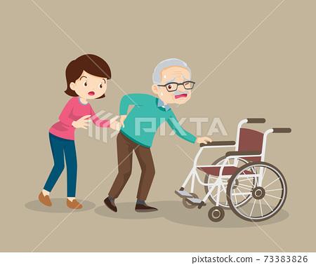 Women helping the elderly patients to wheelchair 73383826