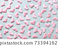 Pattern of pink love hearts on blue. Valentine's day 73394162