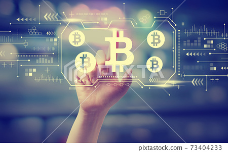 Bitcoin theme with hand pressing a button 73404233