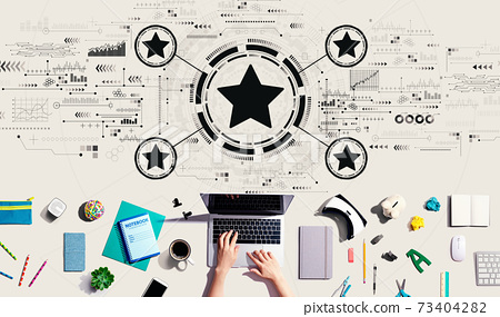 Rating star concept with person using a laptop 73404282