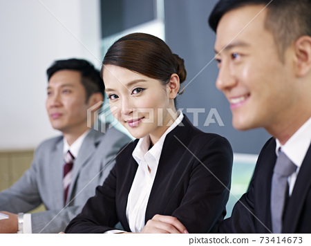 three asian business people meeting in office 73414673