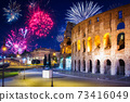 Fireworks display over the Colosseum in Rome, Italy 73416049