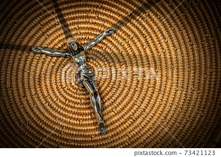 Jesus on the Cross - Silver Crucifix on Woven Wicker Texture 73421123
