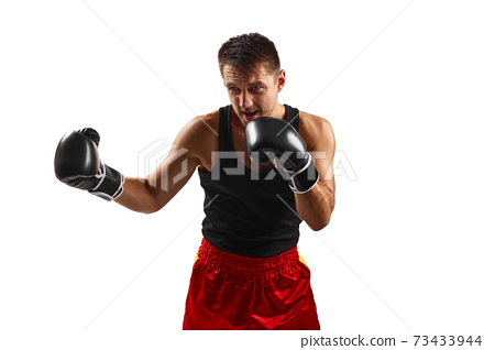 sporty man in black boxing gloves punching 73433944