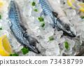 fresh mackerel on crushed ice with lemon 73438799