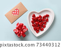 Heart red sweets, love letter and gift on blue. Valentine's day romantic invitation. 73440312