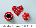 Red heart sweets, gift and cup of coffee on blue background. Valentine's day. 73440313