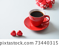 Red cup of coffee, heart sweets and gift cookies on blue background. Valentine's day. 73440315