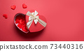 Valentine's Day romantic red box in shape of heart on red. 73440316