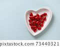 Heart red sweets, love letter and gift on blue. Valentine's day romantic invitation. 73440321