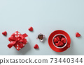 Red heart sweets, gift and cup on blue. Valentine's day. 73440344