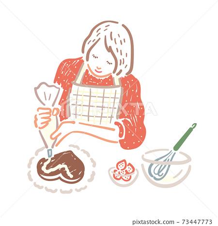 一個女人在手工巧克力蛋糕上擠奶油 73447773