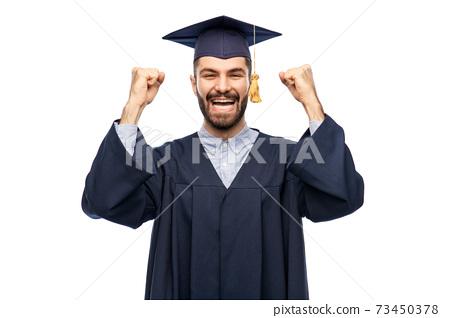 happy graduate student in mortar board 73450378