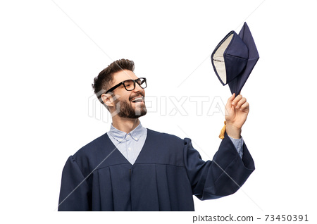 graduate student in bachelor gown with mortarboard 73450391