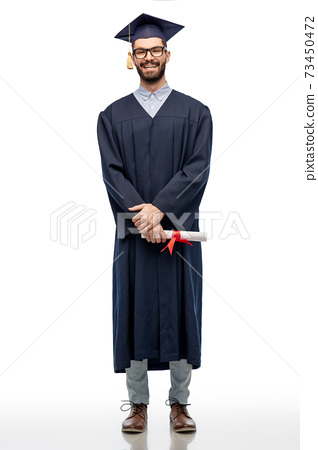 male graduate student in mortar board with diploma 73450472