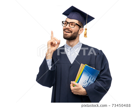 happy graduate student pointing his finger up 73450488