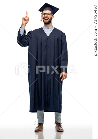 happy graduate student pointing his finger up 73450497