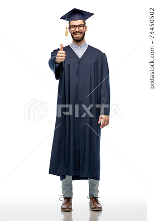happy male graduate student showing thumbs up 73450502
