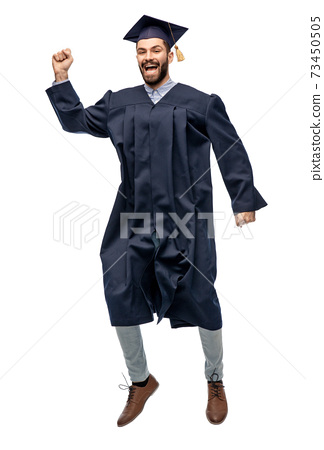 happy male indian graduate student jumping 73450505