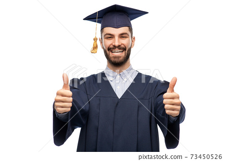 happy male graduate student showing thumbs up 73450526