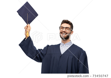 graduate student in bachelor gown with mortarboard 73450747