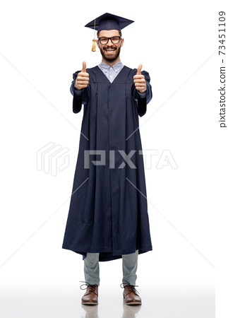 happy male graduate student showing thumbs up 73451109