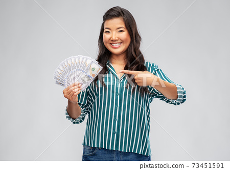 asian woman with hundred dollar money banknotes 73451591