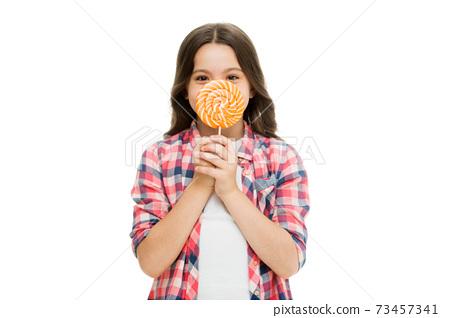 Food addictions. Girl kid eat sweet lollipop. Happy childhood. Sugar  73457341