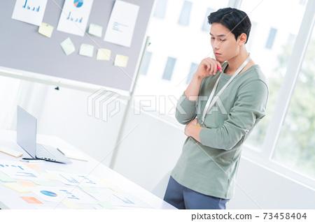 Businessman working 73458404
