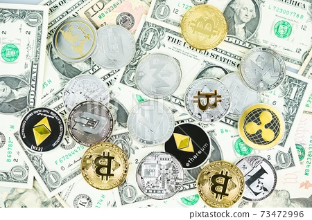 Various cryptocurrency coins on dollar banknotes. Bitcoin, ethereum, litecoin and others modern virtual currency 73472996