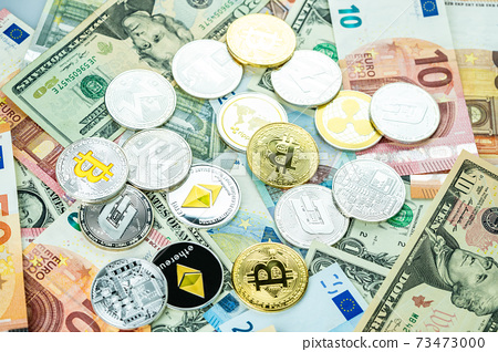 Various cryptocurrency coins on paper dollar and euro banknotes. Bitcoin, ethereum, litecoin and others modern virtual currency 73473000