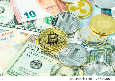 Various cryptocurrency coins on paper dollar and euro banknotes. Bitcoin, ethereum, litecoin and others modern virtual currency 73473001