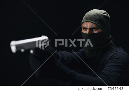 Dangerous offender aiming with real gun 73473424