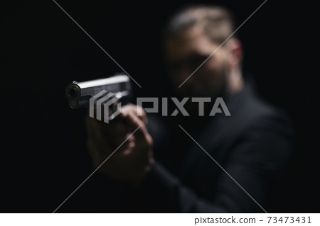 Blur background of gangster holding gun 73473431