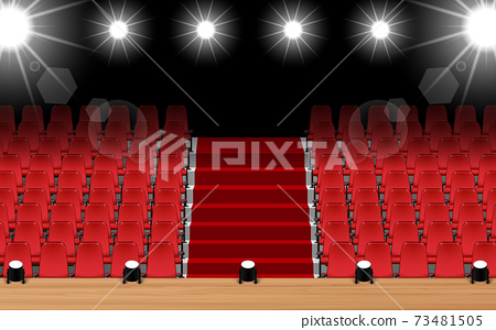 wooden stage with spotlight and red seats in the hall 73481505