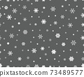 Seamless pattern of white snowflakes on a gray background 73489577