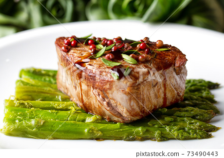 Beef Fillet With Pink Pepper and Asparagus. 73490443