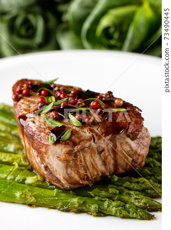 Beef Fillet With Pink Pepper and Asparagus. 73490445
