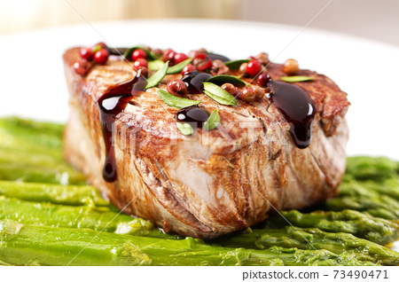 Beef Fillet With Pink Pepper and Asparagus. 73490471