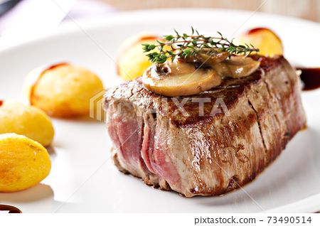 Fillet of beef with mushroom sauce and potatoes. High quality photo. 73490514