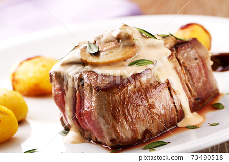 Fillet of beef with mushroom sauce and potatoes. High quality photo. 73490518