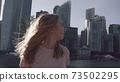 Woman Look At Skyscrapers 73502295